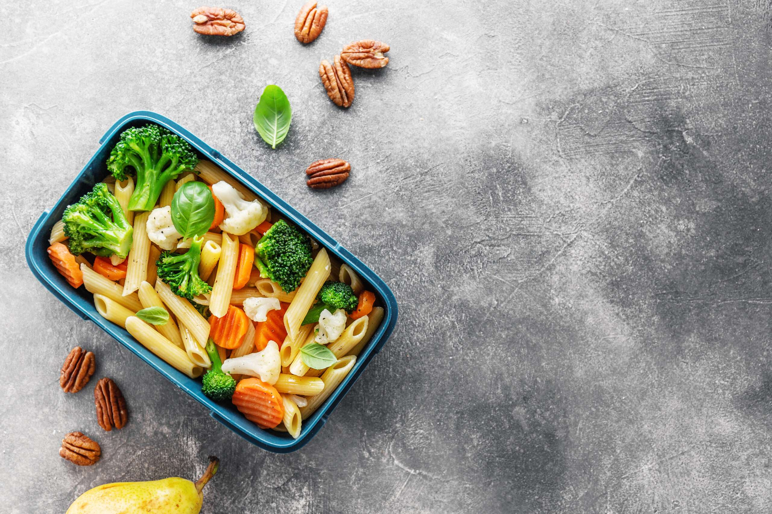 child's Healthy lunch with pasta, vegetables and fruit