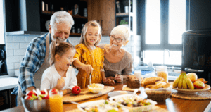 parents and children preparing healthy food together
